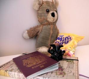 Passport, journal, mini eggs, teddy bear, Ganesha