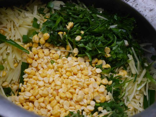 Cooking kitchuri (a rice and lentil dish)