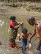 Auntie, Uncle and Roshni fishing in our pond