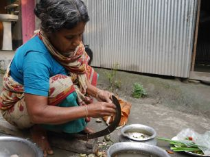 Dadi preparing vegetables